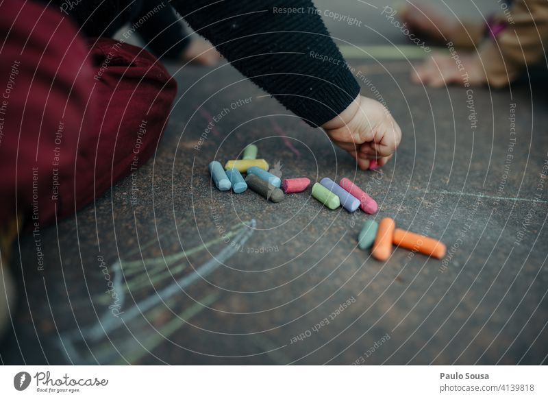 Child drawing with colored chalk on the floor Close-up 1 - 3 years Chalk Chalk drawing Draw Infancy Playing Art Exterior shot Leisure and hobbies