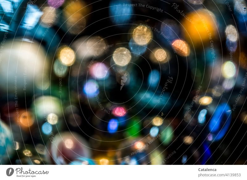 Bright, colorful spots of color on a black background structure shape colors luminescent Round Glimmer Light Design Reflection Abstract Glittering blurriness