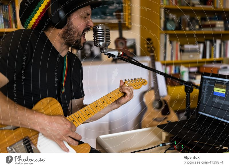 Making music Musician recording Studio shot Podcast Microphone Guitar Guitarist Colour photo Technology Equipment Sound tool Artist Record audio Acoustic
