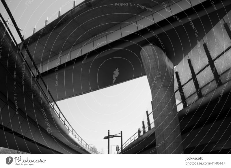 Urban highway over and next to each other Bridge Bridge pier Cloudless sky Bridge construction Architecture Contrast Traffic infrastructure Manmade structures