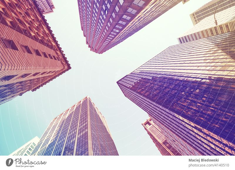 Looking up at Manhattan skyscrapers, color toned picture, New York City, USA. city office business building look up cityscape skyline NYC travel new york
