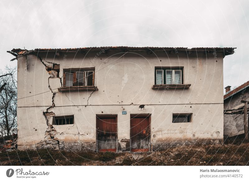 old ruined house with cracked walls in European village ancient antique architecture backdrop brick brown building cement city construction crumbling debris