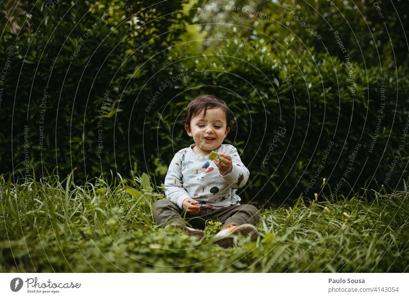 Child playing in the park 1 - 3 years Caucasian Authentic Nature Green Day Human being Infancy Colour photo Lifestyle Exterior shot Toddler Joy Happiness