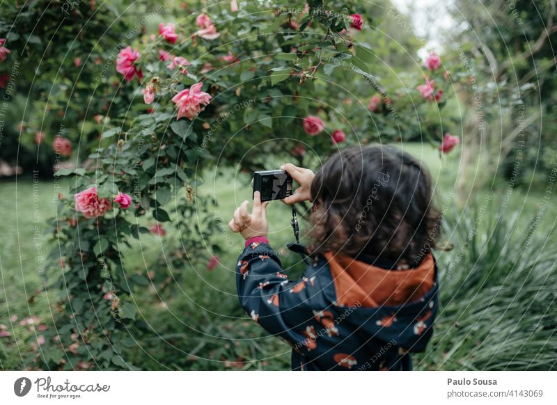 Child taking photos with digital camera 1 - 3 years Girl Caucasian Authentic Camera Digital photography Technology Infancy Human being Colour photo Lifestyle