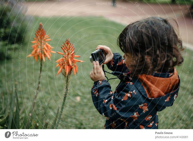Cute girl taking photos Child 1 - 3 years Caucasian Photography Camera Digital Digital photography Technology travel Infancy Beautiful Portrait photograph Joy