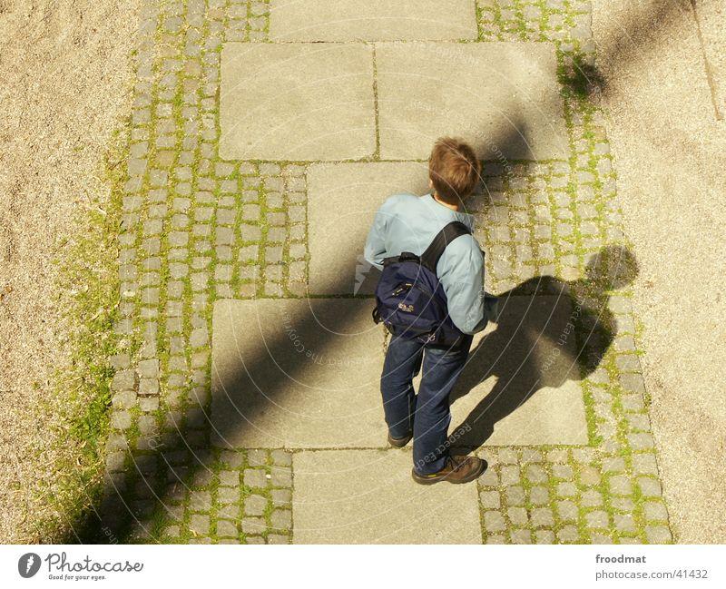 diagonal shadow Bird's-eye view Backpack Man Shadow Cobblestones Crazy Looking away Sand Paving stone