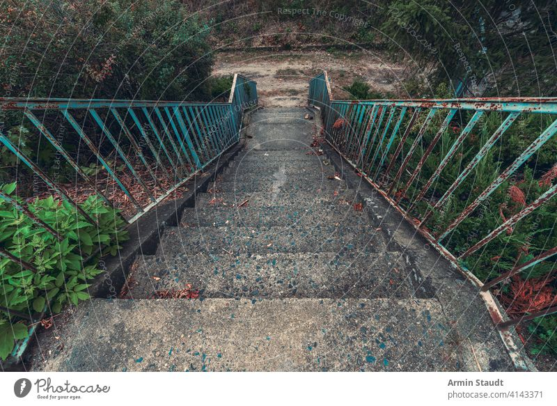 old concrete staircase with rusty blue railing abandoned ancient architecture background construction dirt down gray grunge handrail iron life metal nature