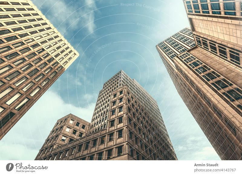 vintage style skyscrapers with backlight architecture background building business business district city cityscape downtown estate exterior facade finance high