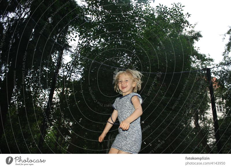 happy bouncing child fortunate Hop Girl Jump Joy Trampoline Joie de vivre (Vitality) Playing Child Happiness Happy Movement Emotions cute Romp Energized Funny