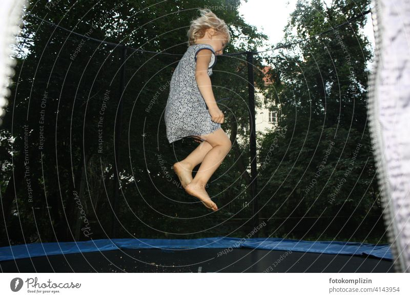 Child bouncing on a trampoline Trampoline Hop Skip Children's game Energized vitality Leisure and hobbies Gymnastics cheerful move Airy Joy jump feel free