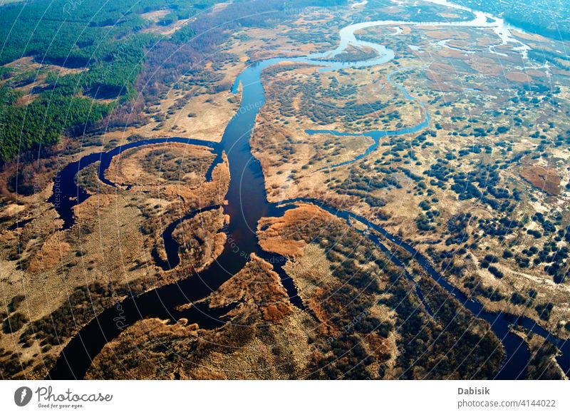 Overflowing river in the valley, aerial view nature steppe landscape texture field green pattern stream terrain drone amazing scenery water environment blue
