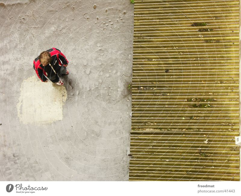 from above Bird's-eye view Corrugated iron roof Concrete Two-piece Man Derelict Human being
