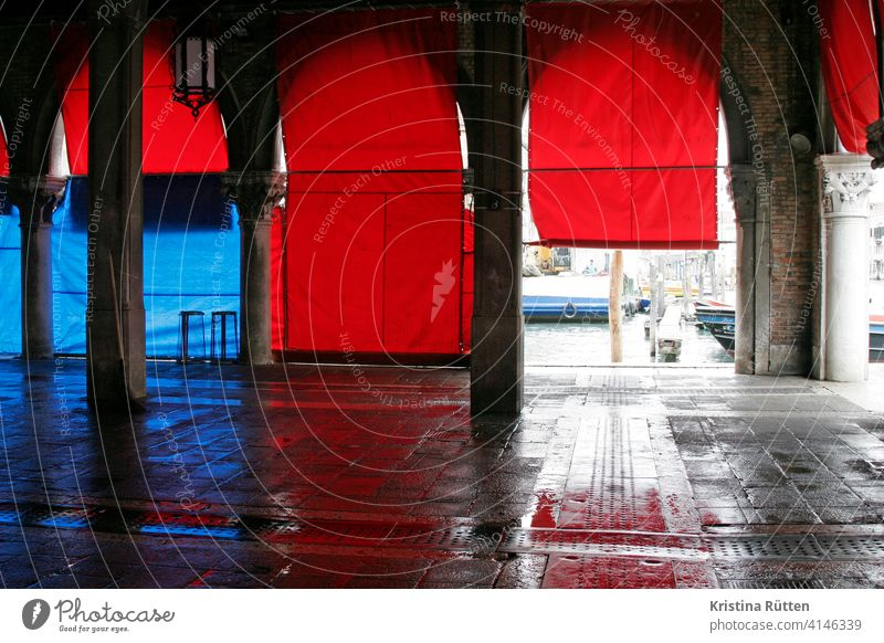 red blinds at the fish hall in venice Fish market Covered market Roller blinds Red Blue Arcade columns Architecture Empty Moody Closing time Wet pescheria