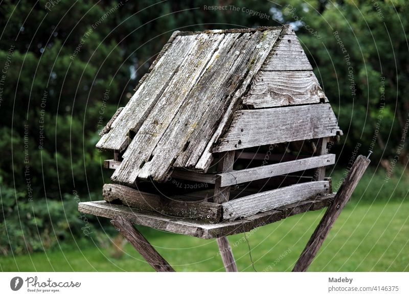 Homemade birdhouse for the winter made of old grey wood at the edge of the forest on a farm in Rudersau near Rottenbuch in the district of Weilheim-Schongau in Upper Bavaria