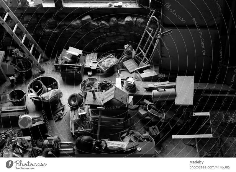 Tools and objects in the workshop of a craftsman in an old barn on a farm in Rudersau near Rottenbuch in the district of Weilheim-Schongau in Upper Bavaria, photographed in classic black and white