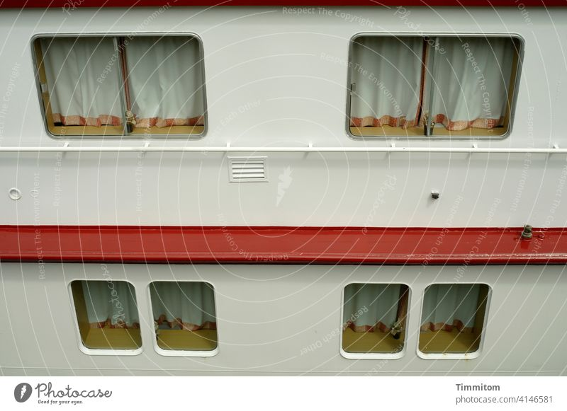 The river cruise ship also takes a break Navigation Break standstill Window drapes Closed Nothing works Exterior shot Deserted Passenger ship