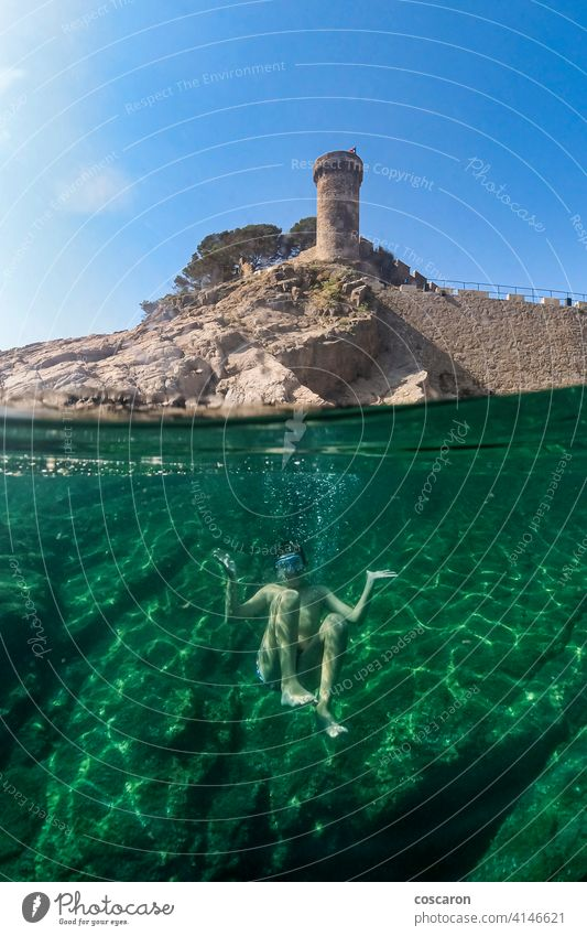 Little boy snorkeling with a castle in the background active apnea beach caribbean child childhood cute dive diver enjoying enjoyment exploration fun half happy