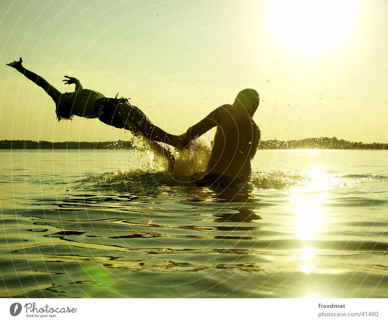 Human being Youth (Young adults) Water Vacation & Travel Sun Summer Beach Joy Playing Jump Lake Friendship Moody Swimming & Bathing Leisure and hobbies