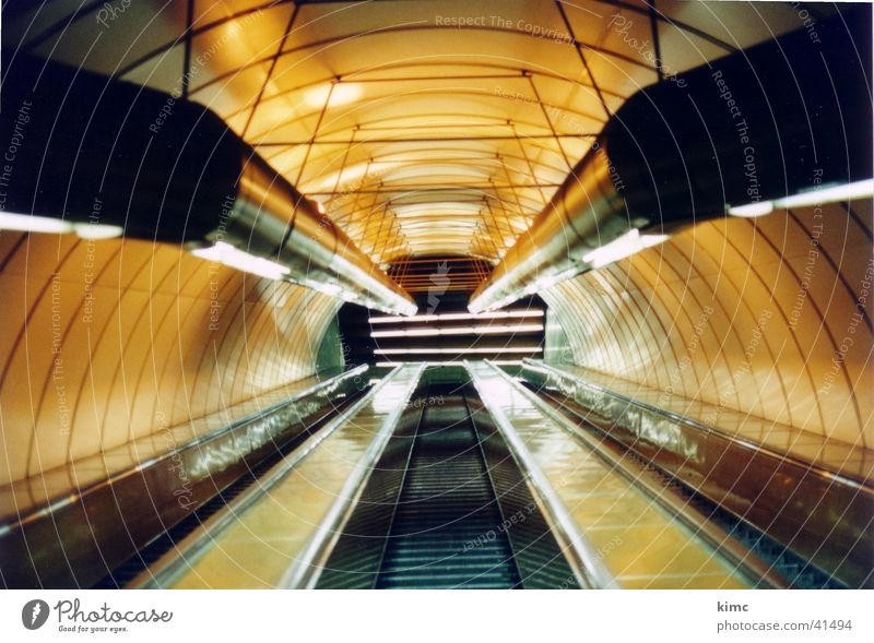 Metro escalator in Prague Escalator Underground Vanishing point Yellow Architecture Light (Natural Phenomenon) Pipe