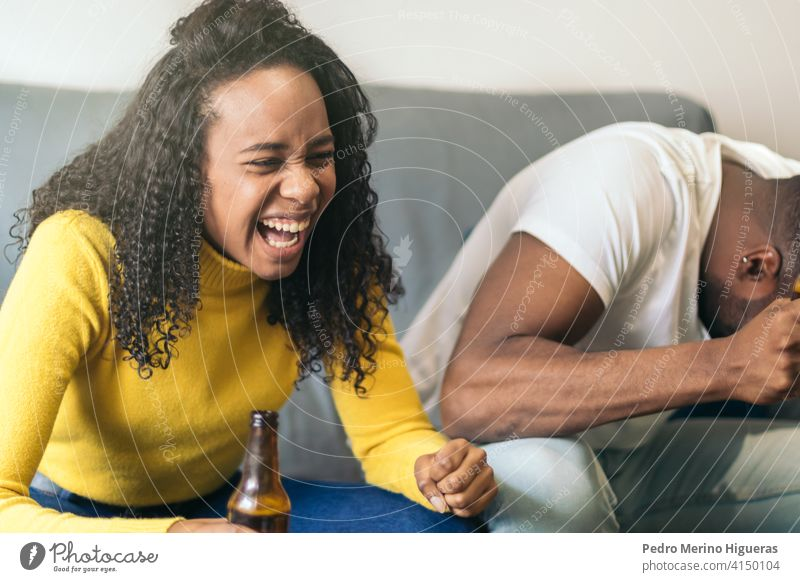 black couple laughing and drinking beer at home african party happy american alcohol fun friends smiling together friendship person female lifestyle people afro
