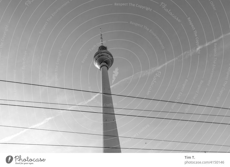 The Berlin TV Tower from below Overhead line Television tower Middle Downtown Berlin Landmark Alexanderplatz Sky Capital city Architecture Tourist Attraction