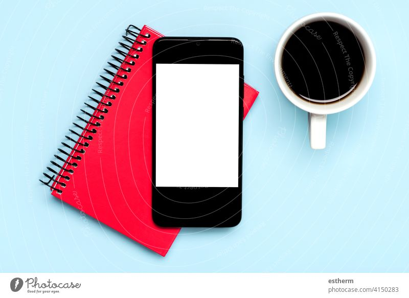 smartphone with white screen for copy space with white cup of coffee and red diary office telecommunication networking message social banner lifestyle business