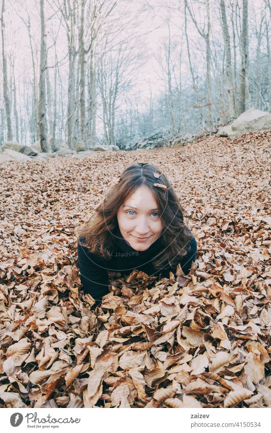 woman enjoying autumn leaves outdoor fall season background leaf nature girl lifestyle foliage cheerful yellow beauty adult leisure colorful fun happy young
