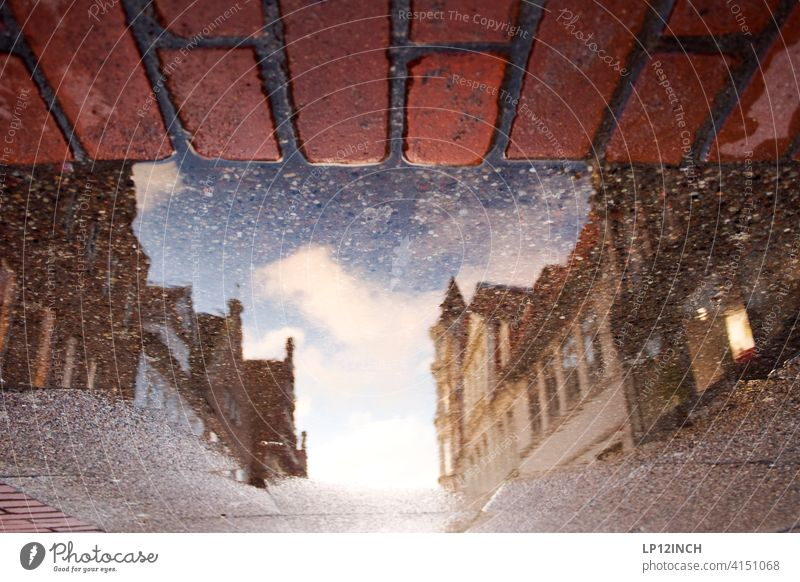 Lüneburg shopping mile Puddle Town Reflection in the water puddle photo House (Residential Structure) Old town Building City trip Shopping street Ground surreal