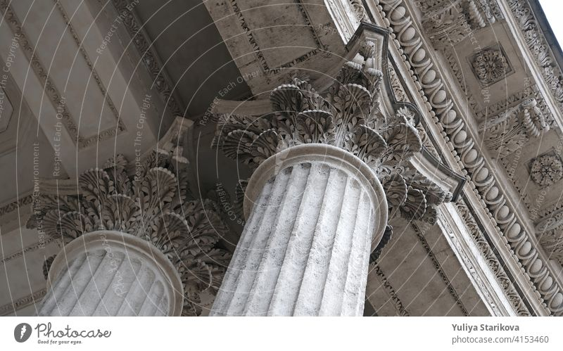Classic architectural column. Details of the architecture of a historical building. Element of exterior building with columns and Stucco molding on the ceiling of Cathedral in St. Petersburg, Russia.