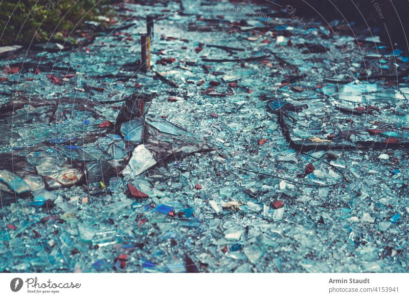 close up of colorful glass shards covering the ground abstract accident background break broken crack cracked crash crushed damage debris destruction dust earth