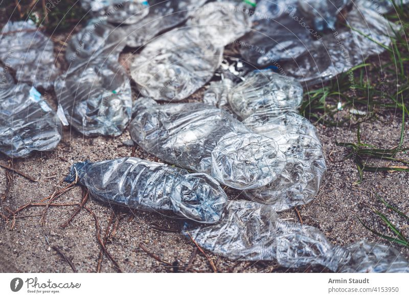 old crushed plastic bottles lying on the floor background beverage closeup dirty discarded earth eco ecological ecology empty environment environmental garbage
