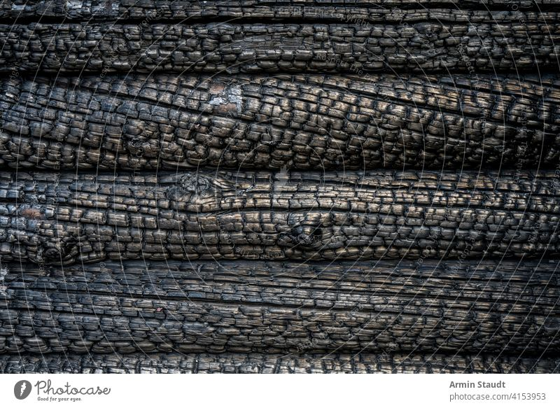 close up of a charred wall of a blockhouse abstract aged background black burn burned burnt charcoal closeup damaged dark design destruction fire golden grunge