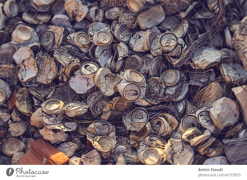 close up of a big heap of old crushed aluminum cans aluminium background beer beverage blank broken closeup compressed crumpled destruction dirt dirty drink