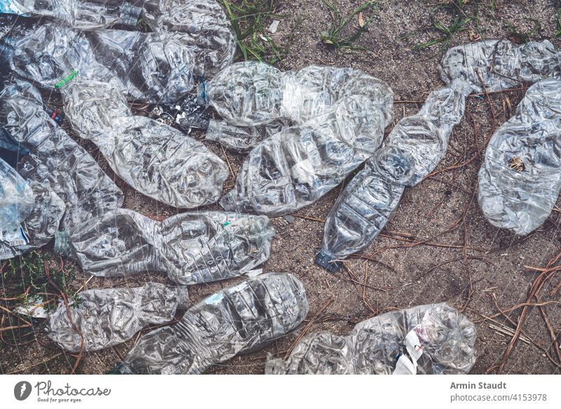 old crushed plastic bottles lying on the floor background beverage dirty discarded earth eco ecological ecology empty environment environmental garbage global