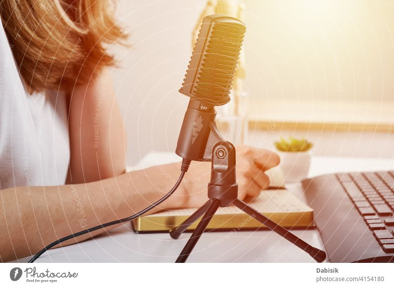 Woman in headphones listen audio cource. podcast education learning online microphone online education broadcasting studio radio blogger media music equipment