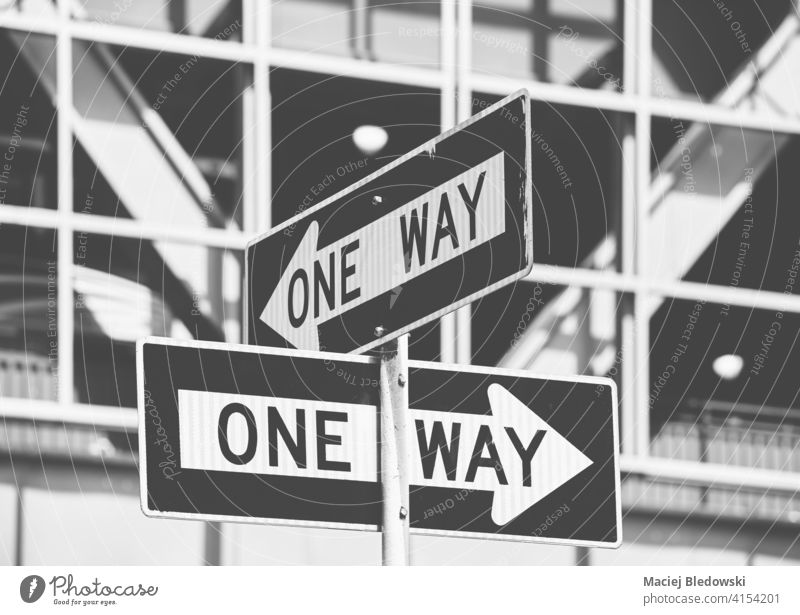 Black and white picture of One Way road signs in New York City, selective focus, USA. one way city traffic black white street direction Manhattan NYC travel