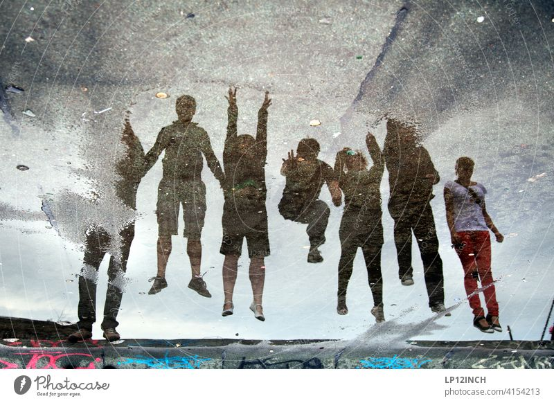 Puddle jump Team spirit people group Peer pressure reflection 7 Jump muck about surreal Friends Friendship Attachment Departure take off