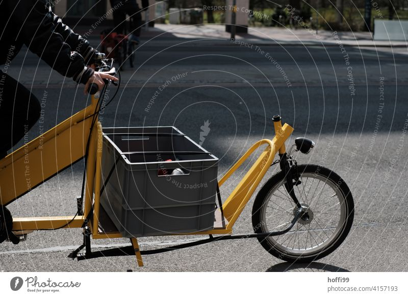 yellow cargo bike on the road Freight bike Wheel Alternative delivery service delivery traffic Shipping Bicycle Mobility Logistics Cycling Means of transport