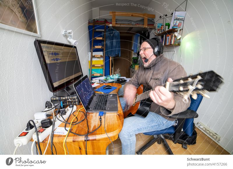 Man sings, plays guitar and records this on computer Sing Guitar Make music Computer take sound recording Loud Microphone Singer Song Music Musical instrument