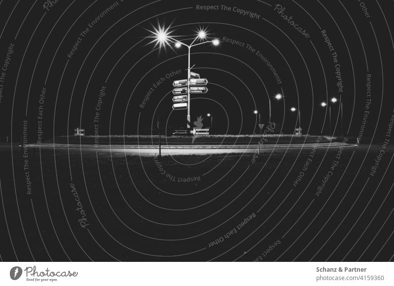 Roundabout with signposts in Belgium Rond point Gyroscope streetlamp Road marking France Night out at night Navigation GPS proceed Dark Lonely Illuminated