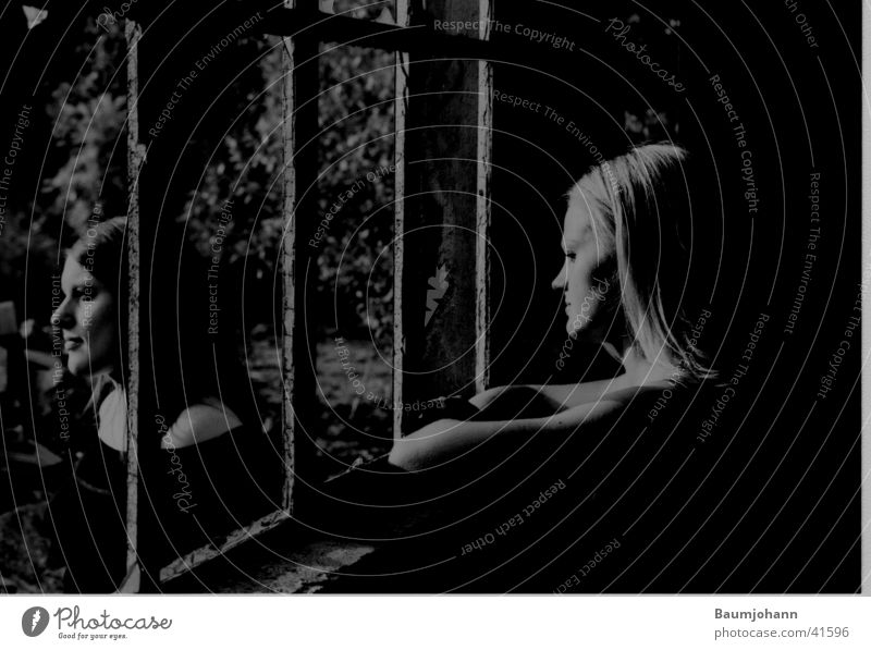 Together alone Grating Window Portrait photograph Silhouette Woman Black & white photo partially exposed Profile