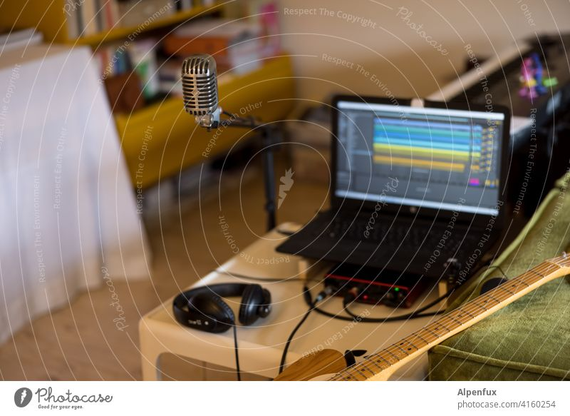 Home podcasting Musician recording Studio shot Podcast Microphone Guitar Guitarist Colour photo Technology Equipment Sound tool Artist Record audio Acoustic