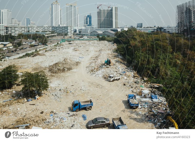 building site in southeast asia aerial architecture automotive boom business city cityscape commerce community construction day development dirt downtown