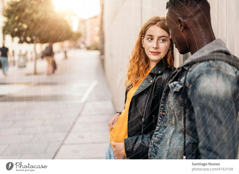 Lovely Multiethnic Couple copyspace looking at each other front view portrait relationship multi-racial black man caucasian multi-cultural multi-ethnic together