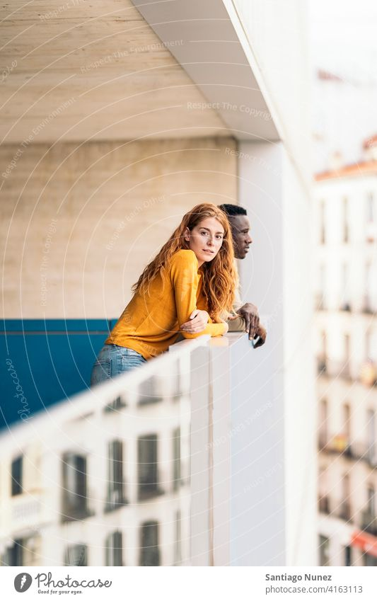 African Boy and Redhead Woman looking at camera standing front view portrait relationship multi-racial black man caucasian multi-cultural multi-ethnic together