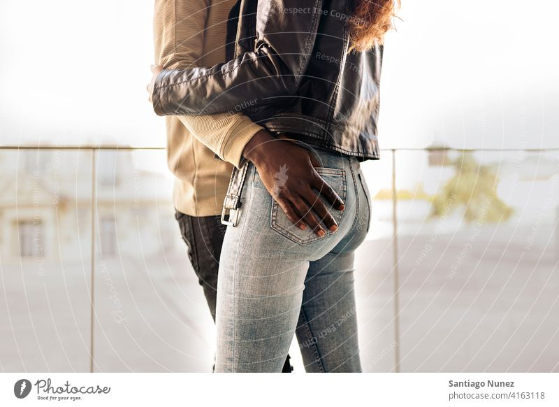 Loving Couple faceless anonymous couple affection intimacy unrecognized two standing legs touching loving front view portrait relationship multi-racial