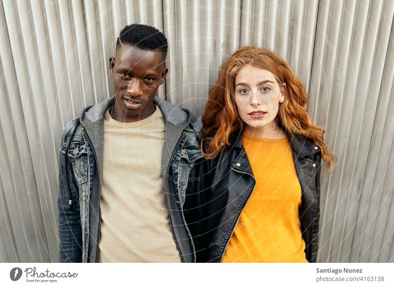 Ginger Head Woman and Afro Boy looking at camera two portrait ginger head woman male front view relationship multi-racial black man caucasian multi-cultural