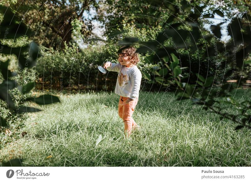 Cute girl playing outdoors Girl 1 - 3 years Caucasian Child childhood Park Spring Colour photo Exterior shot Day Nature Happiness Human being Infancy Lifestyle