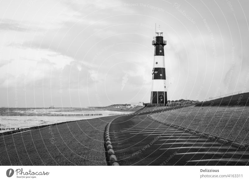 Lighthouse in black and white at the coast, no people lighthouse zeeland breskens zeeuws-vlaanderen the netherlands holland sea beacon ocean ship landscape