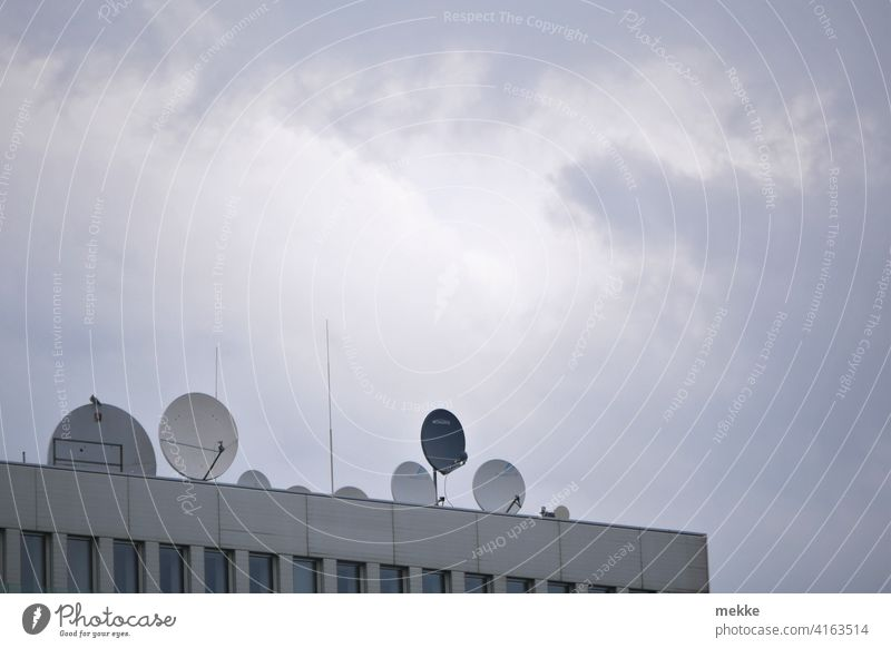 Satellite dishes decorate the modern roof terrace House (Residential Structure) Roof Antenna Town Facade Sky Building Clouds Satellite Dish Radio Television